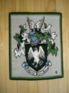 Vert, A Falcon Rising Argent